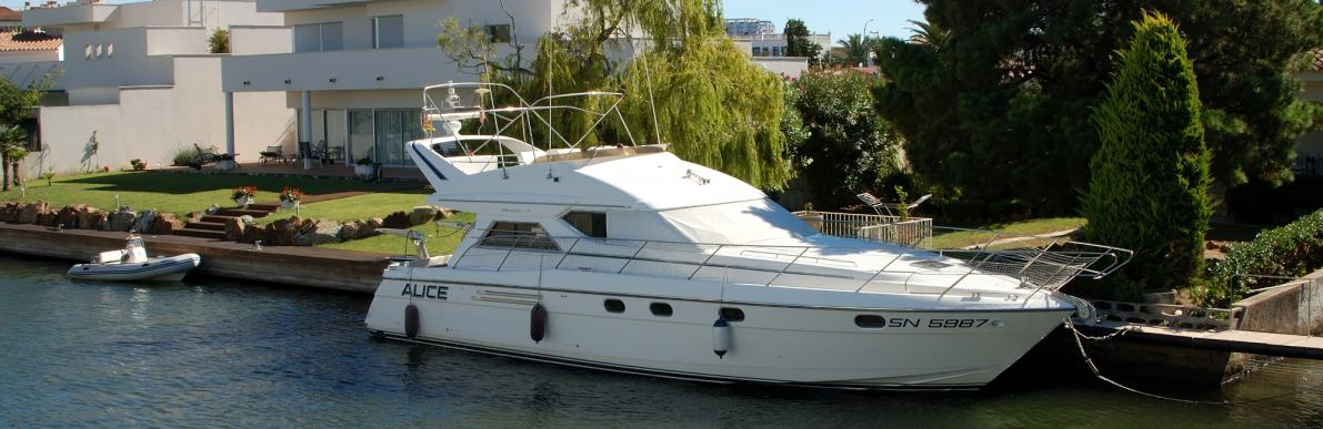 Yacht on mooring of villa in Empuriabrava