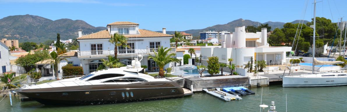 Yacht moored on the dock of villa in Roses Santa Margarita
